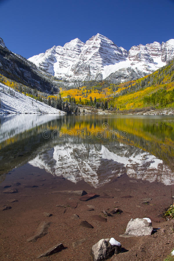 Maroon Belles Colorado. The Maroon Belles of Colorado near Aspen are some of the most photographed mountains in the United States. This photograph shows the stock image