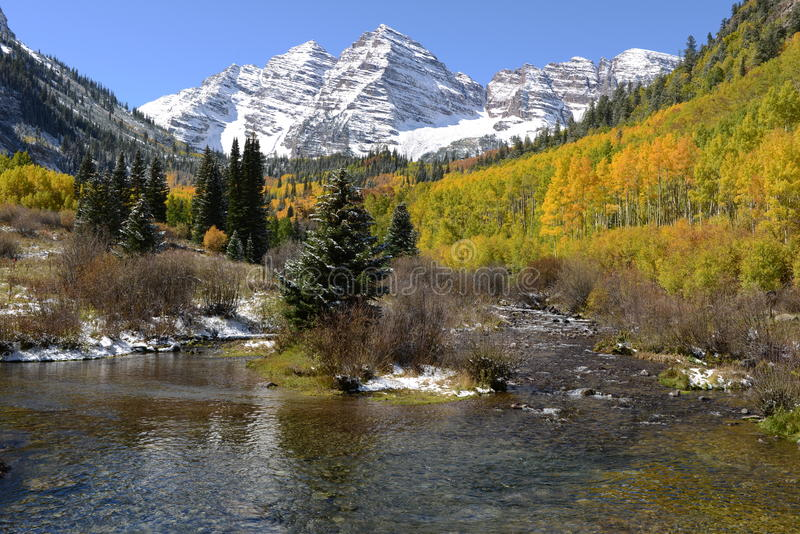 Maroon Bells and Creek in Autumn stock photo