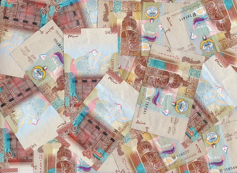 Maroon Quarter Dinar Kuwait Banknotes Blended Into A Financial Backdrop. Maroon Quarter Dinar Kuwait Banknotes Blended Into A Banking Backdrop royalty free stock photo