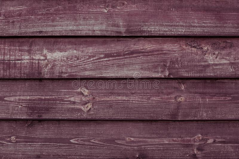 Maroon wood texture background. Vinous wooden plank surface. Burgundy wooden shabby table, fence, barn. Abstract pattern of red lu stock photo