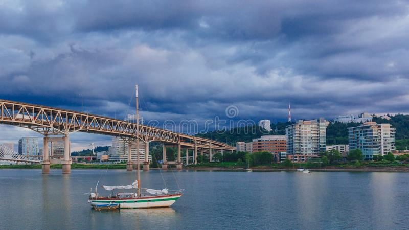 Marquam Bridge over Willamette River with boats in Portland, USA royalty free stock photos