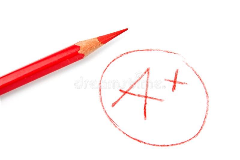 Marque A+ com lápis vermelho imagens de stock royalty free