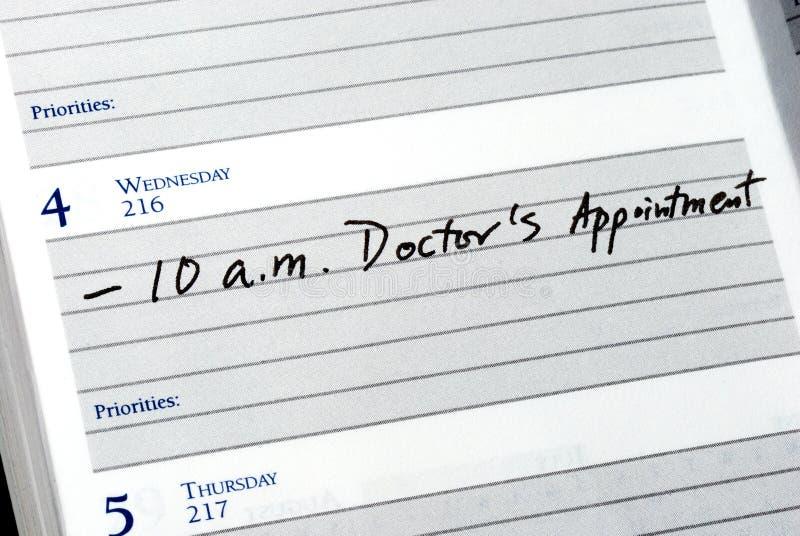 Marque la cita del doctor foto de archivo