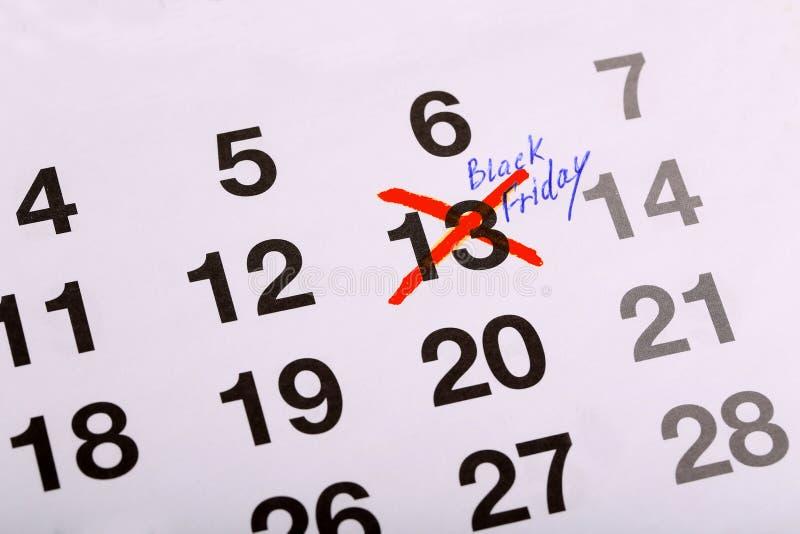 Marque sur le calendrier - vendredi 13 - Black Friday image stock