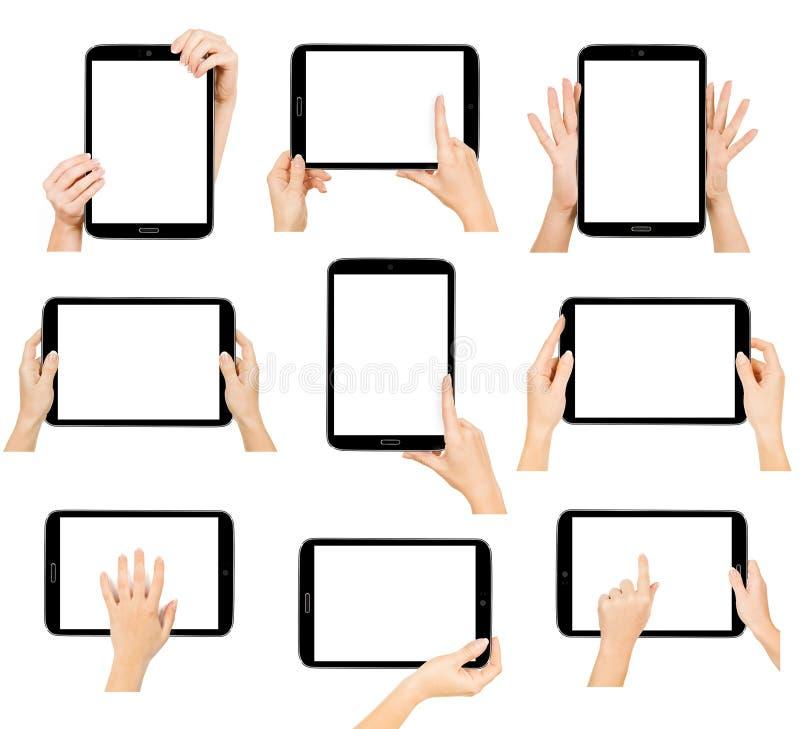 Marquez sur tablette l'ordinateur d'isolement dans une main sur les milieux blancs photos stock