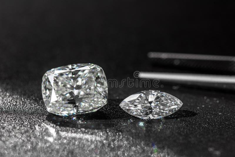 Diamonds and Jewelry Tweezers royalty free stock photography