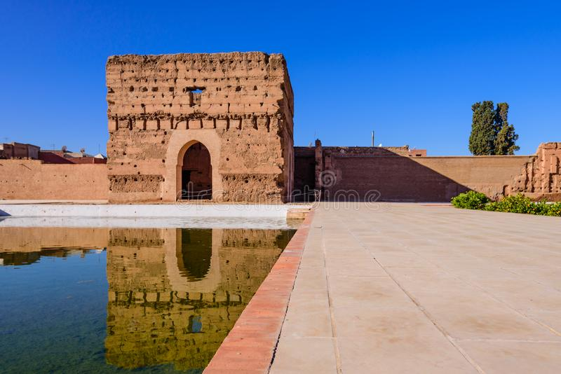 El Badi Palace in Marrakech medina with reflection in water pond. Marrakech, Morocco - December 9, 2018: Sightseeing of Morocco. El Badi Palace in Marrakech royalty free stock image