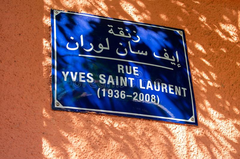 23.9.19 Marrakech, Morocco: Street sign with text Rue Yves Saint Laurent, street name in Marrakech, Morocco stock images
