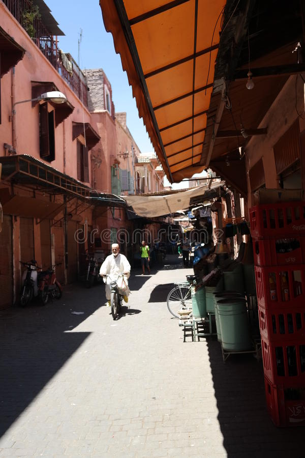 MARRAKESH MARKET. MOTOR SCOOTER IN MOROCCAN ALLEYWAY LIVING CITY LIFE stock photography