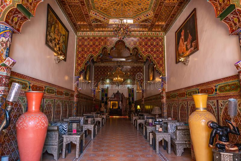 MARRAKESH, MOROCCO - JAN 2019: Inner hall of Riad in Marrakesh, Morocco. Rich riad interior Moroccan style arch stairs. And mosaic stock images