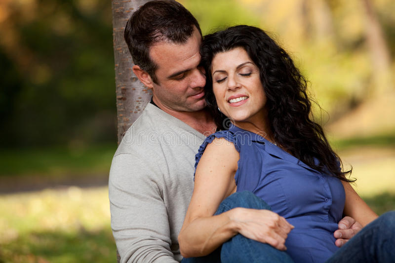 Marriage. A married couple in the park relaxing stock photography