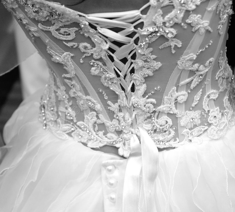 Marriage. This black and white photograph represents a back of wedding dress royalty free stock photo