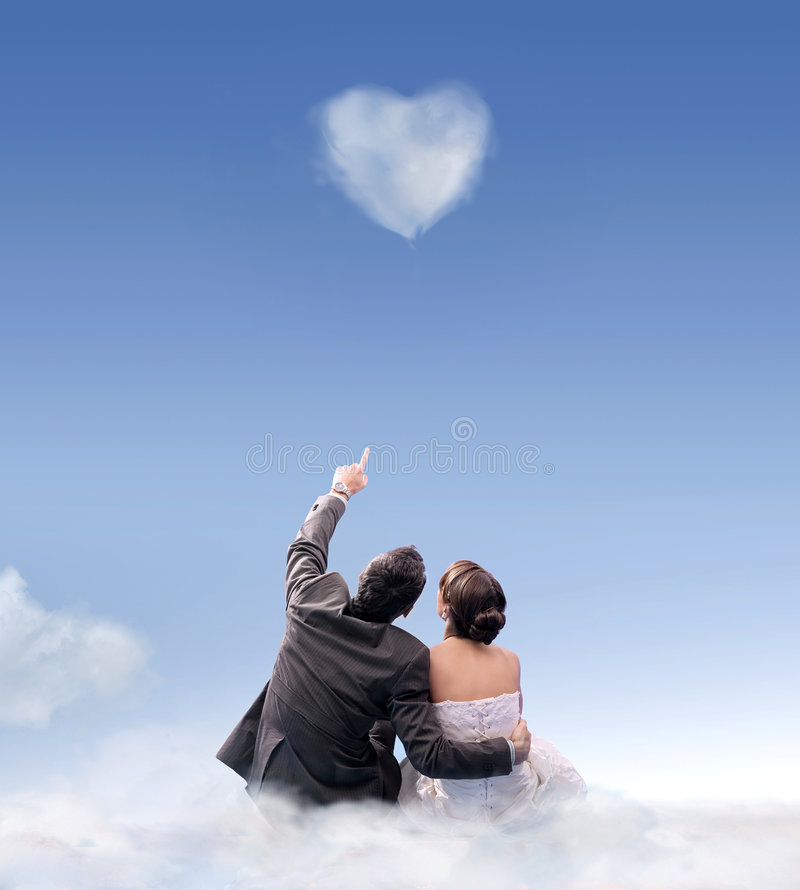 Marriage. Heart of cloud - studio shot of a wedding couple