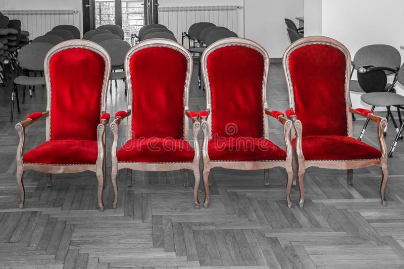 Marriage ceremony chairs. Row of red empty chairs for marriage ceremony. Red color isolated on black and white background stock image