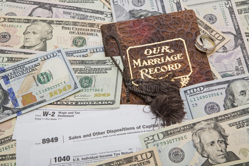 Marriage contract IRS income tax forms. IRS income tax preparation using W-2, 8949 capital gains and form 1040 taxable forms concept of married filing jointly royalty free stock image