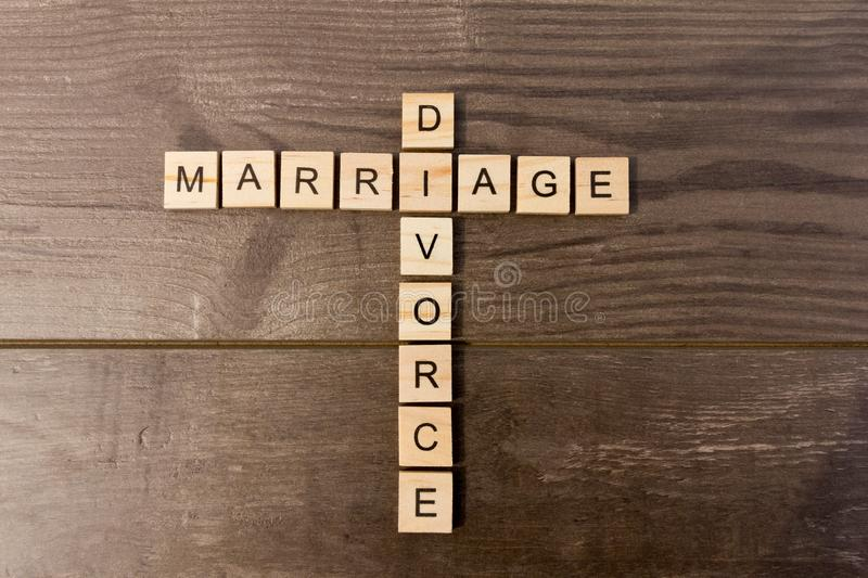 Marriage and Divorce. Words reading Marriage and Divorce arranged on a wooden background stock photography