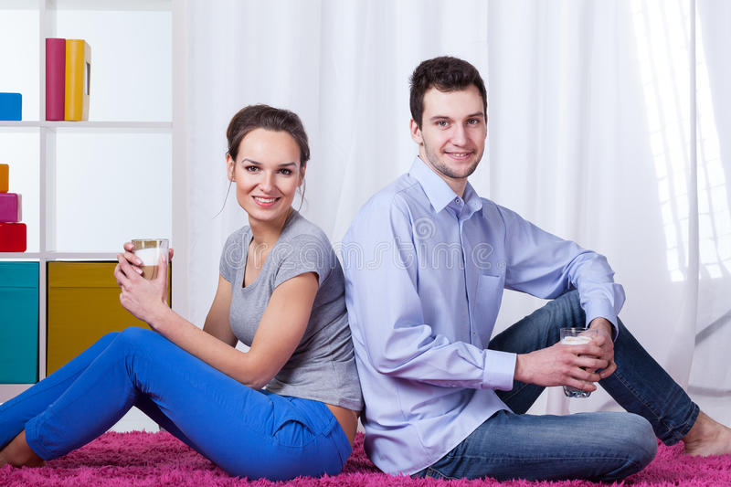 Marriage drinking coffee at home stock image