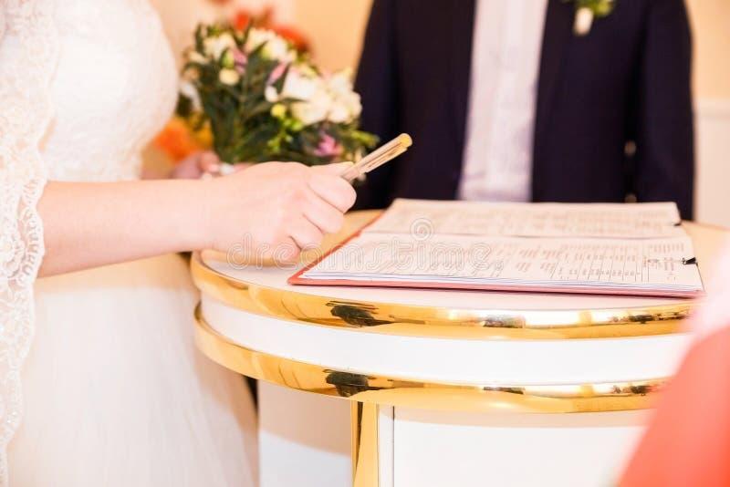 Marriage elegant bride signing register royalty free stock image