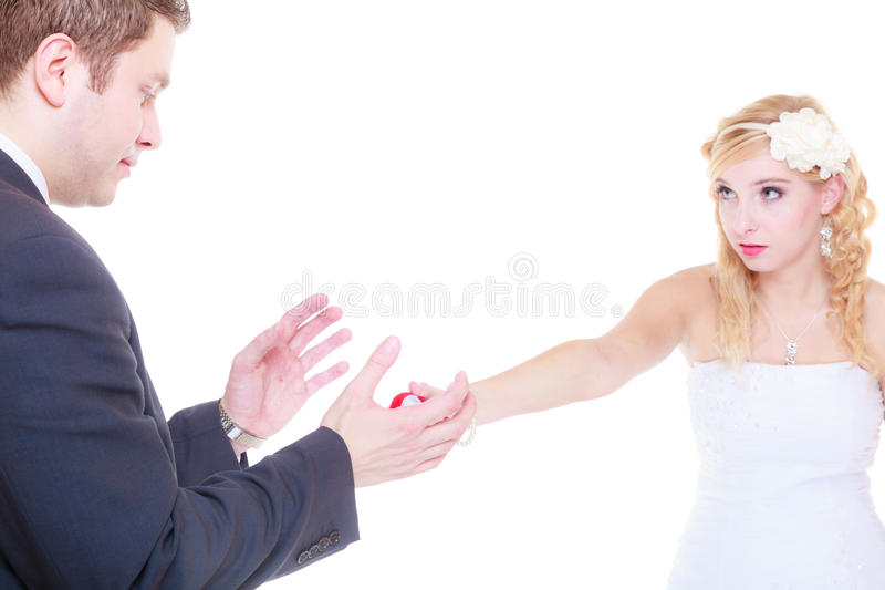 Man proposes to woman, she refuses. Marriage, proposal, future wife concept. Man proposes to women showing beautiful ring, she refuses royalty free stock photos