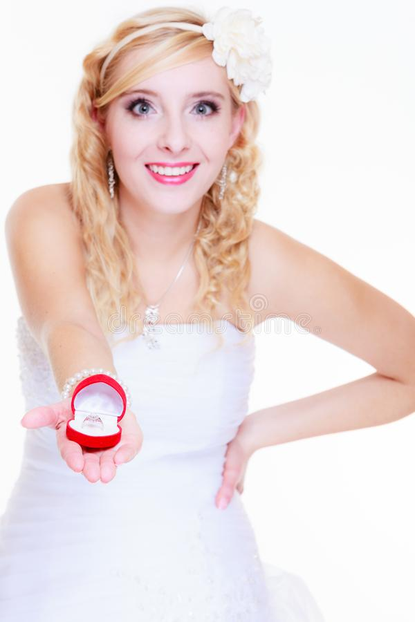 Bride showing proposal ring. Marriage, proposing, future wife concept. Bride wearing white long dress showing proposal ring royalty free stock images