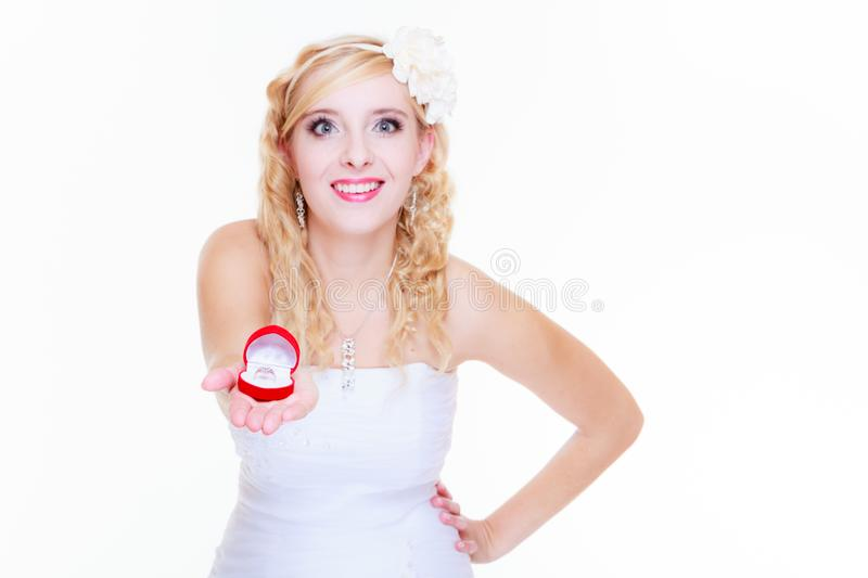Bride showing proposal ring. Marriage, proposing, future wife concept. Bride wearing white long dress showing proposal ring royalty free stock image