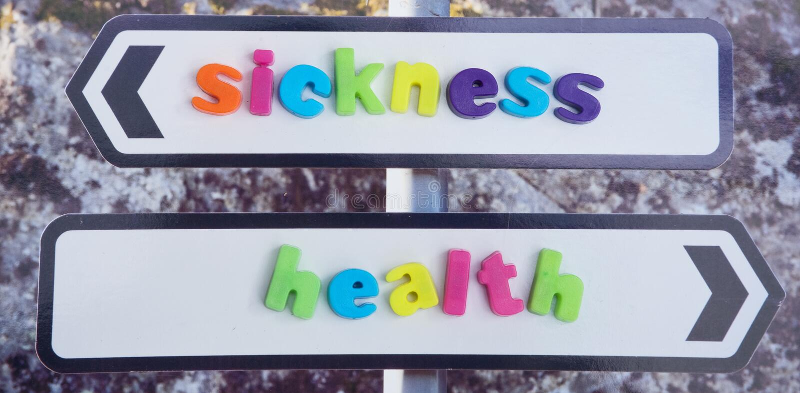 Marriage in sickness and in health. . An image of a sign post with two arrows labeled sickness and health as in the marriage vows. The words are in colorful stock image