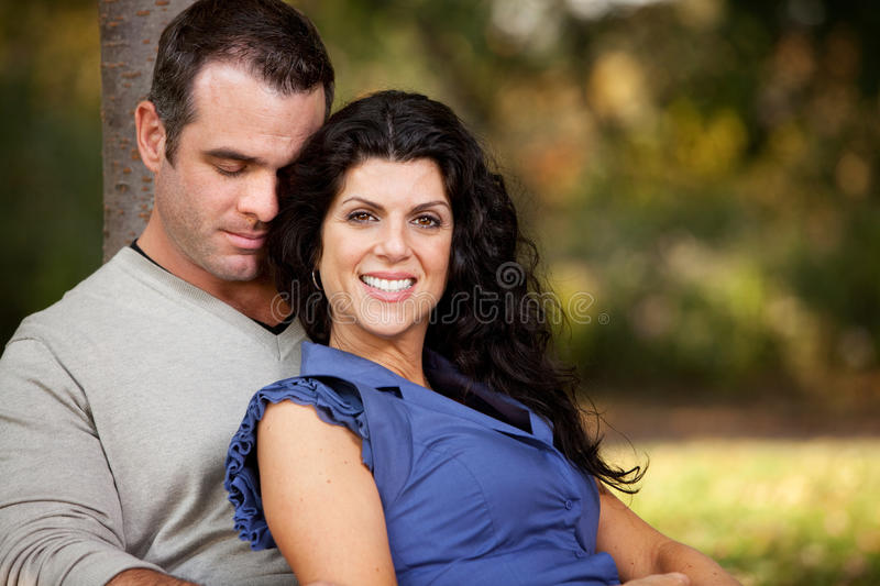 Married Couple. A happy married couple relaxing in the park stock photography