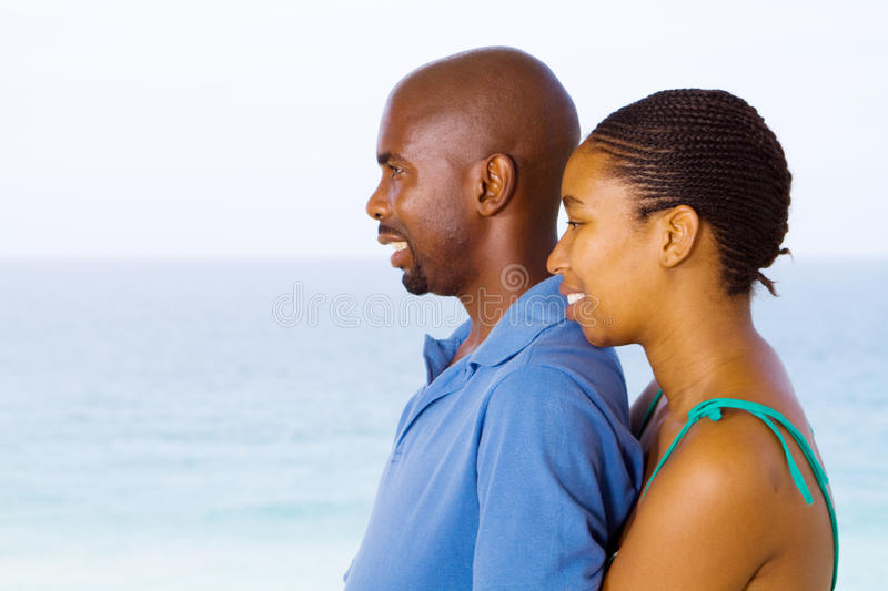 Married couple. Happy african american married couple viewing seascape royalty free stock image