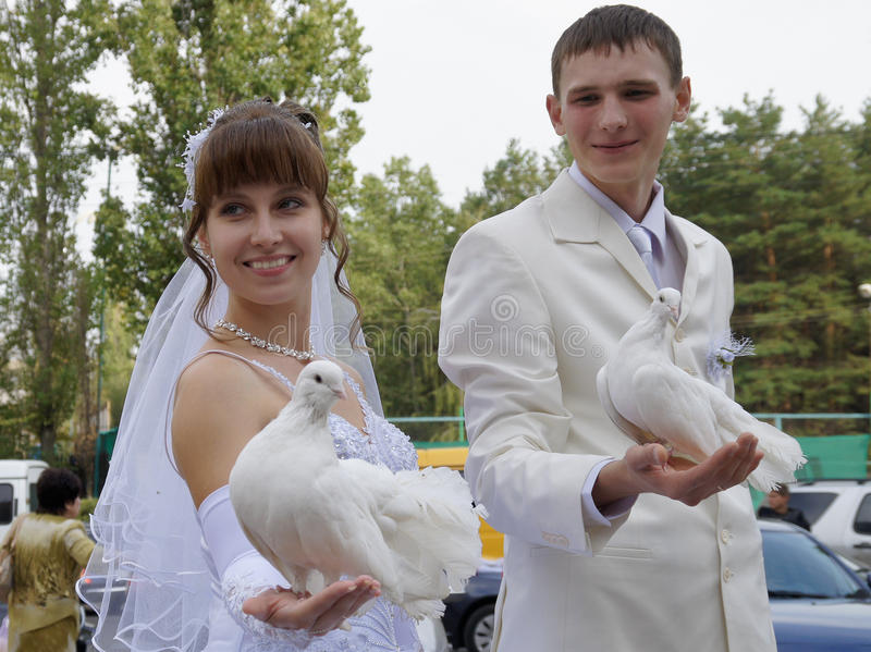 Married couple. With wedding doves royalty free stock image