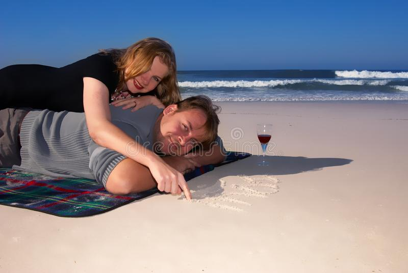 Married couple on the beach stock photography