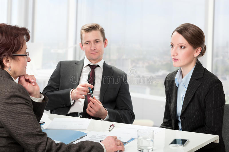 Married couple consults a mature woman lawyer royalty free stock images