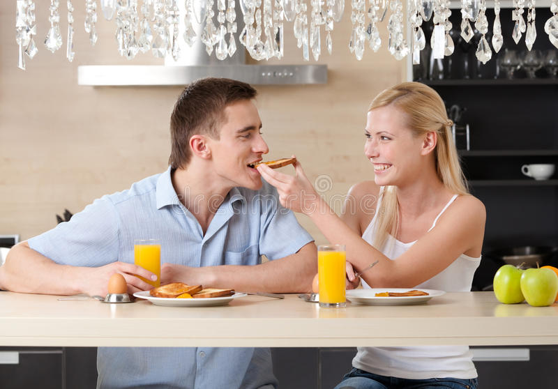 Married Couple Has Breakfast In The Kitchen Stock Photos