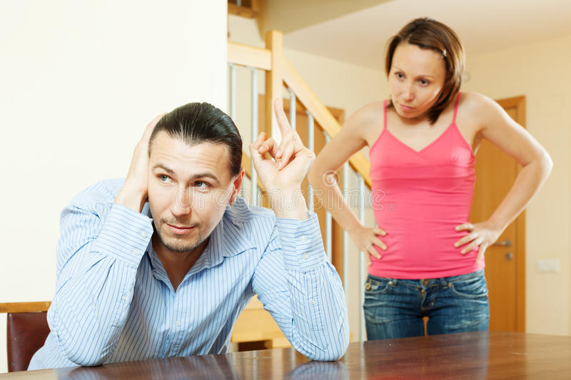Married couple having quarrel. At home interior stock photography