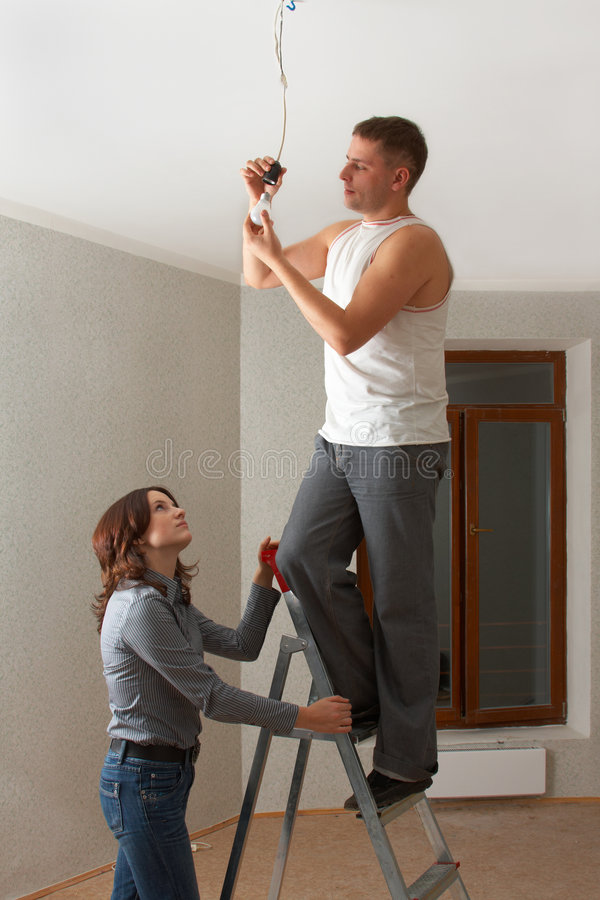 Married couple making major repairs in new flat. stock images