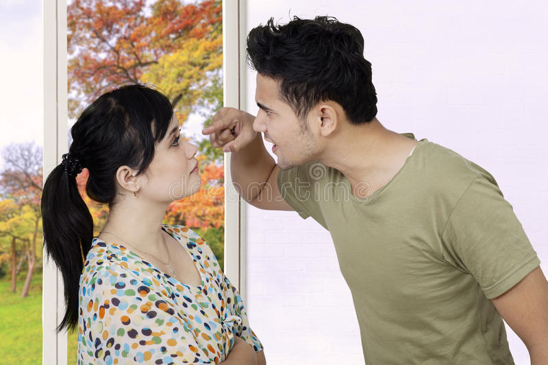 Married couple quarreling at home stock photo
