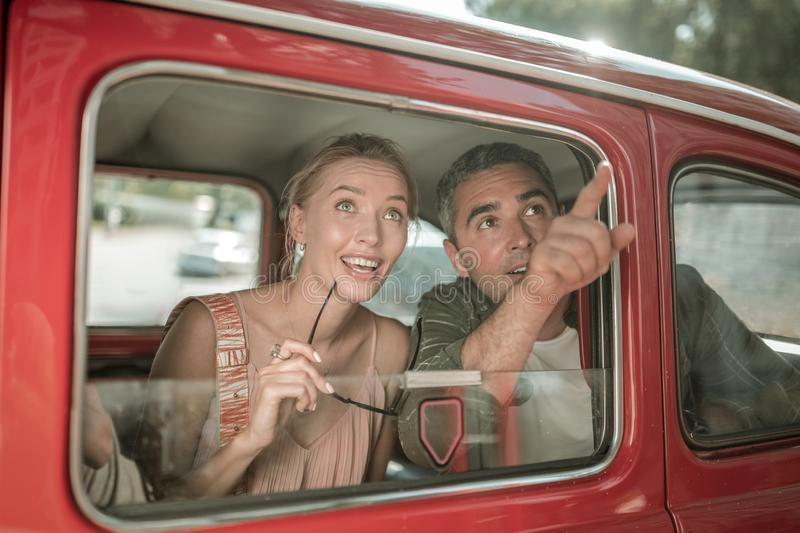Married couple seeing the sights from the car. stock images