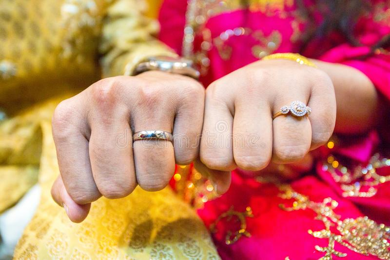 Married couple showing their wedding rings at Bangladesh. Close up image. Couple showing their wedding rings at Bangladesh. Close up image royalty free stock photo