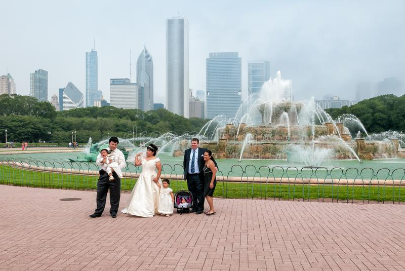 Married couple with their small children visiting Buckingham Memorial Fountain in the Chicago Grant Park. Chicago, Illinois, United States - August 23, 2014 stock image