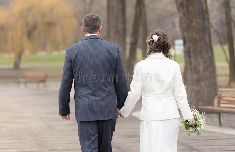 Married couple walking in the park royalty free stock photos