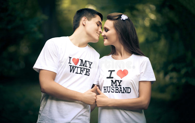Young Husband And Wife With The Words On The T Shirt I Love My Wife I Love My Husband