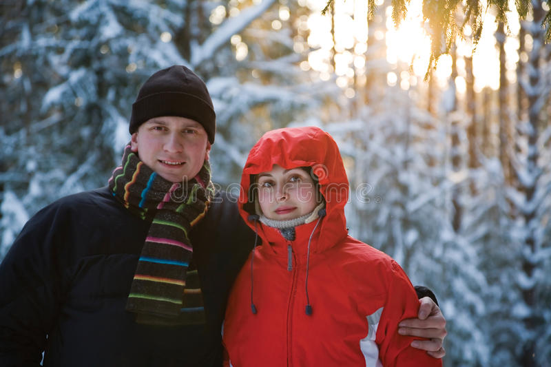 Married couple in winter wood. Married couple on walk in frosty winter wood stock photography