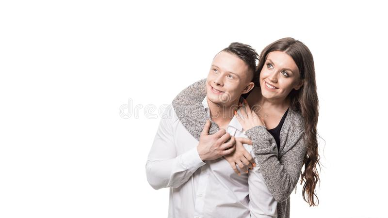 Married couple. Woman holding man and looking by side. Couple goal, happiness, feature, dream and female health concept. stock images