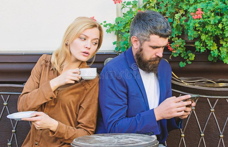 Married lovely couple relaxing together. Couple cafe terrace drink coffee. Couple in love sit cafe terrace enjoy coffee. Man secret messaging cheating on wife stock photos