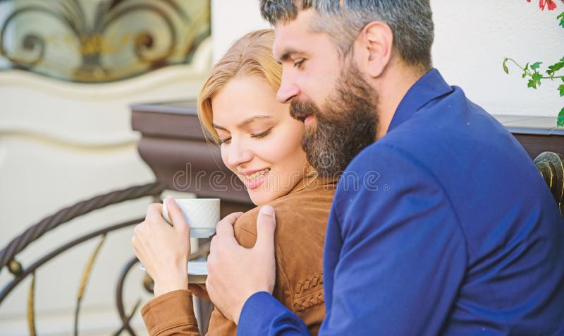 Married lovely couple relaxing together. Happy together. Couple cuddling cafe terrace. Couple in love sit hug cafe stock photos