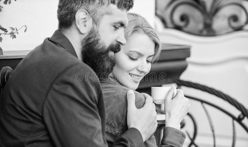 Married lovely couple relaxing together. Happy together. Couple cuddling cafe terrace. Couple in love sit hug cafe royalty free stock images