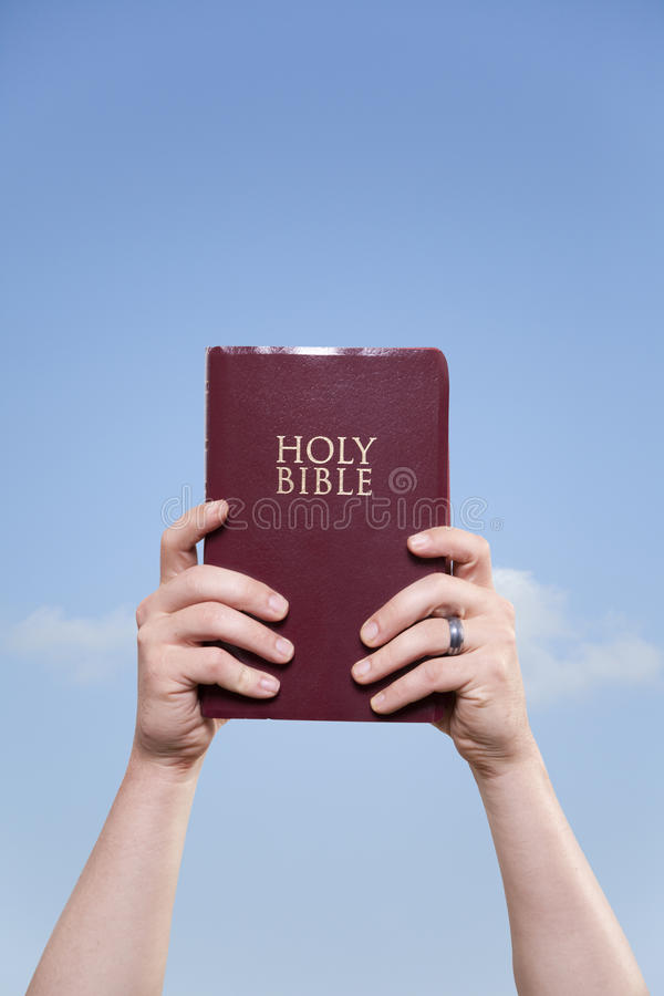 Free Married Man Holding Bible To Sky Royalty Free Stock Photos - 24624928