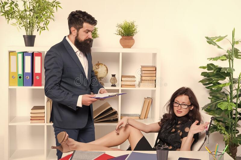 Married to their work. Sexy woman and bearded man run business together. Couple of business partners. Business stock image