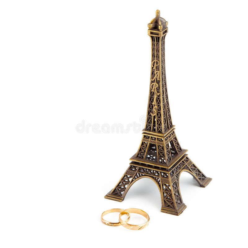 Married under eiffel tower. Effel tower and two gold wedding rings royalty free stock photo