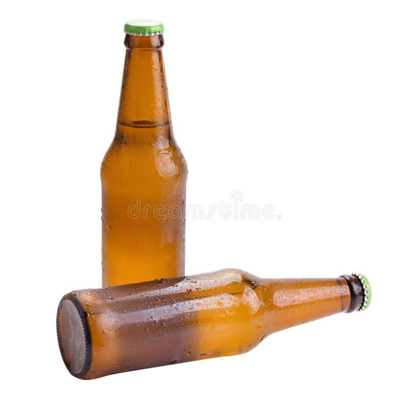 Marrom da garrafa de cerveja isolado no fundo branco foto de stock royalty free