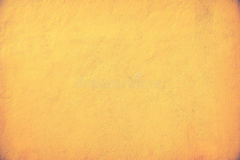 marrom e cor velhos do ouro do fundo da textura do muro de cimento foto de stock royalty free